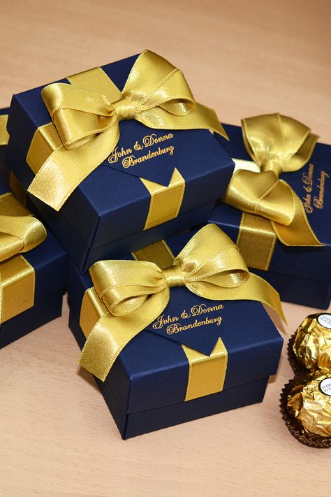 Elegant Navy Blue & Gold wedding party favor gift box with satin ribbon bow and names. Personalized wedding bonbonniere make great packaging for your favors and a unique way to thank guests for attending your big day. #partyfavorbox #giftboxes #personalizedgifts #weddingfavor #weddingfavors #favorboxes #weddingfavorideas #bonbonniere #navybluewedding #burgundywedding #weddingparty #weddingfavour  #weddingfavorideas #bonbonniere #weddingparty #sweetlove #navyandgold #navybluewedding #goldwedding