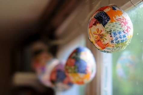 Beautiful colored lanterns made by using balloons, Mod Podge, and fabric scraps