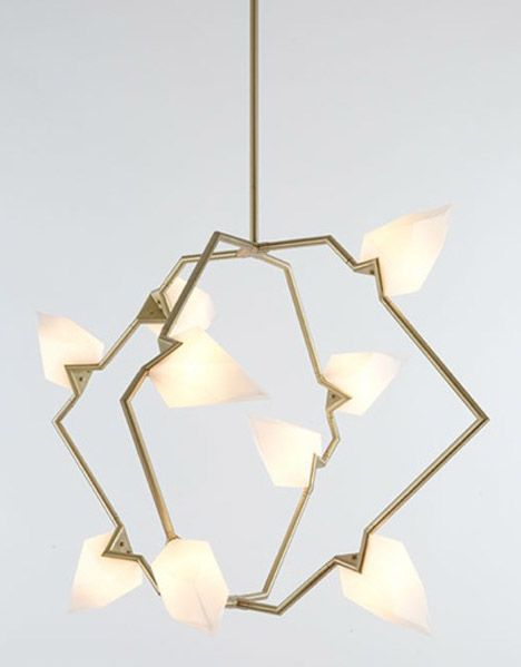 Frosted glass crystals appear to grow from metal tubes connected with miter joints into hexagons to create Brittain's Seed series of lamps.