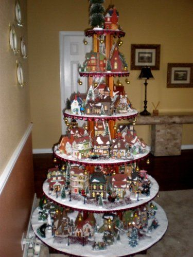 Felicia, you could get your brother or husband to build this and find one of the revolving Christmas tree stands and put all of Granna's Christmas houses on it.