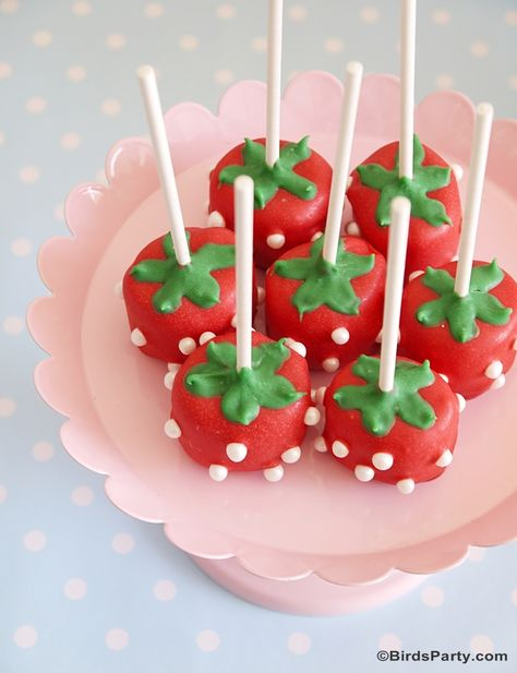 Strawberry shaped cake pops or marshmallow pops.