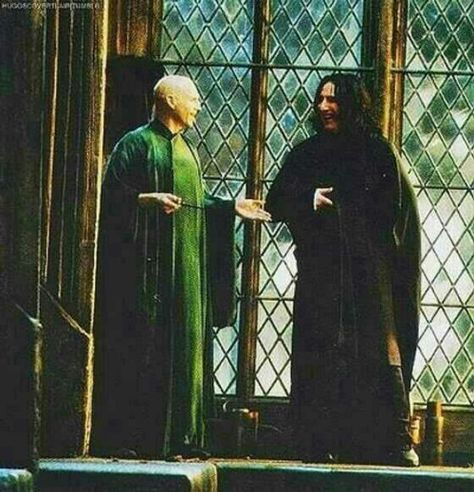 """behind the scenes shot of Ralph Fiennes as Lord Voldemort and Alan Rickman as Severus Snape """"Nice backstage photo."""""""