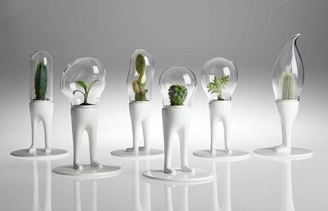 """Domsai Terrarium --- """"Plant invaders! Or space age homes for your seedlings. """"Hand crafted in Italy, each of these gorgeous, anthropomorphic planters are one of a kind. Designer Matteo Cibic refers to his little creations as a tamgochi for your table, but we like to think of them as a little (actually, at 11""""high, not SO little) space-age homes for your cactus or seedlings. They are made of hand cast ceramic and mouth blown glass. $139 #plants"""