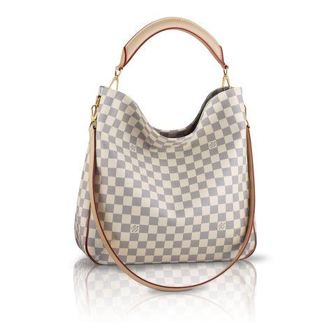 Soffi via Louis Vuitton, FABULOUS!!!! but too bad it picks up color easily ;(
