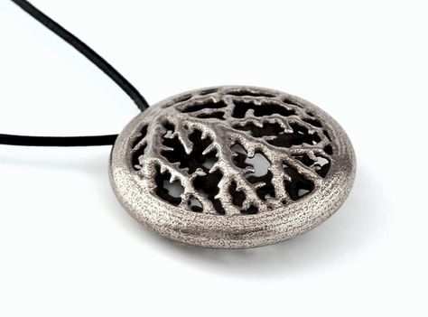 The veins of a leaf are not unlike to a human bloodstream. We're part of a manifold evolution and all is based on the same protozoon. We're not special or superior and we should remind this more often.    Stainless steel whistle pendant, manufactured via Shapways 3D printing service.