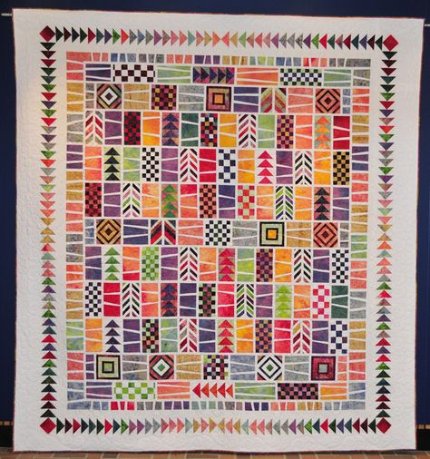 """Summer Sunshine Quodlibet"" by Linda Yatzor (Morgau-Yayzor), machine quilted by Barb Raisbeck.  The color palette was inspired by an orange hand dye fabric.  White was chosen for the lattice to give the quilt a fresh summer feeling.  The Quodlibet pattern is by Judy Hashieder: http://www.quiltwithjudy.com"