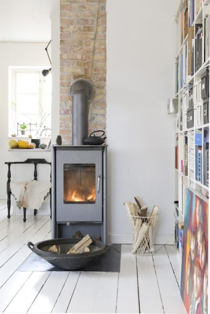 Wonderful wood burning stove in Copenhagen. I could see something like this added in a little house, or a bedroom, bath or kitchen...