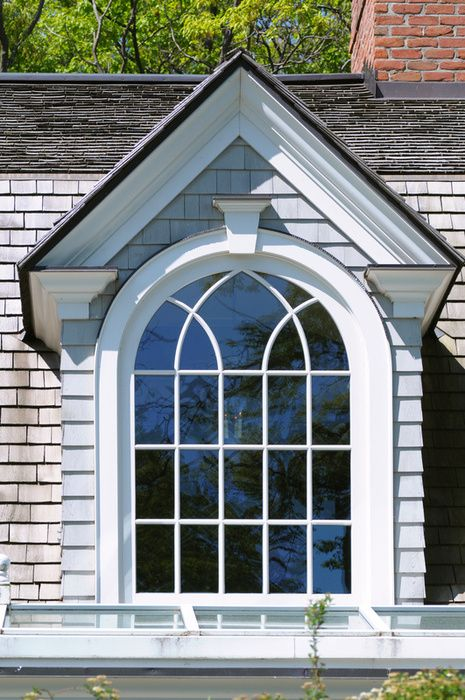Dormer Window: Vertical window protruding through sloping roof. Gable dormer  if it has it's own gable or a shed dormer if a flat room.