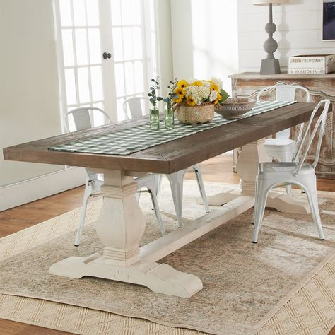 This classic farmhouse dining table is formed from reclaimed pine and hand finished to preserve the natural beauty and variation of the wood grain. Contrasting colors in the dark stained top and light trestle legs add an eclectic artistry that you'll love to share with company. Seats up to eight people. Farmhouse Dining Room Table, Farmhouse Furniture, Modern Farmhouse Table, Kitchen Dining, Narrow Dining Room Table, Distressed Kitchen Tables, Farm Style Dining Table, Natural Wood Dining Table, Painted Dining Room Table