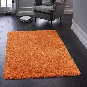 Buddy Orange Washable Plain Rug By Origins Made From 100 Polypropylene Frisee This Pet Friendly Rug Is Known For Its Feature Packed Plain Rugs Rugs Washable