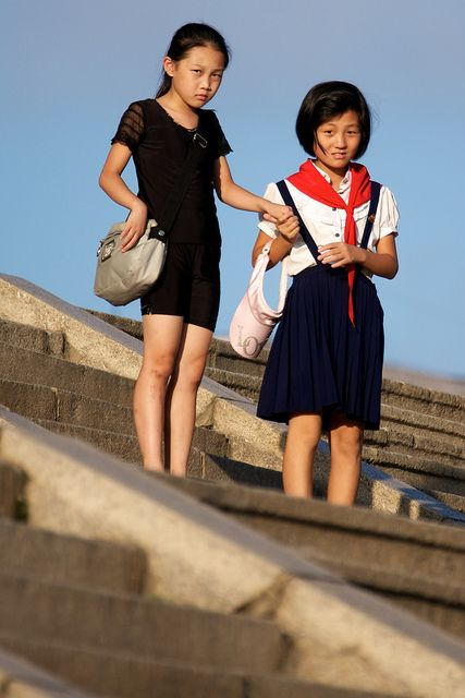Children of North Korea. It's so sad looking at these young girls. I shutter to think what their lives r like and what they have to look forward to. I pray for their safety.