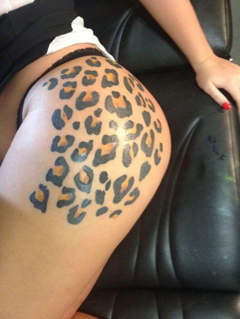 Cheetah print scratch tattoos