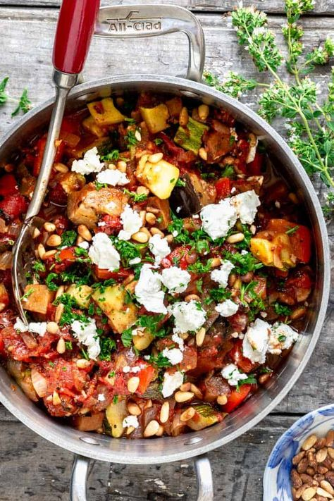 How to make 30 minute ratatouille on the stovetop. It is a traditional Provencale French stew which can be served warm or cold. Top it with goat cheese and pinenuts.