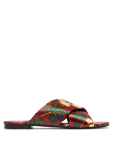 burgundy nike flip flops with gold check