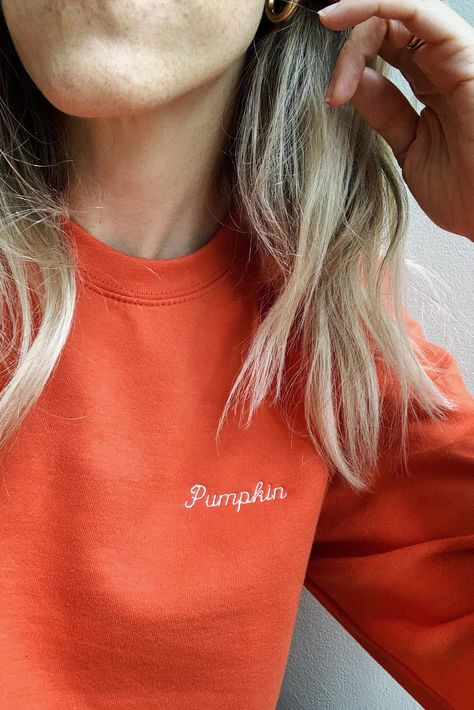 The sweatshirt you'll be living in all fall long. 100% cotton with aged white embroidered Pumpkin on a burnt orange unisex crewneck sweatshirt.