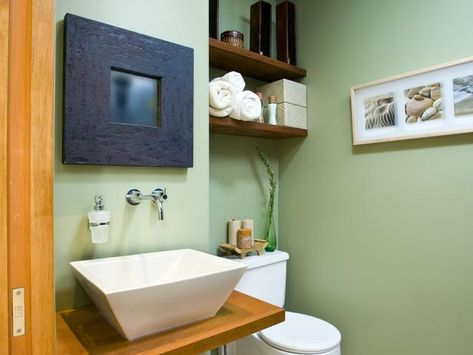 Add function and style by utilizing wasted vertical space. Adding shelves above the toilet maximizes the space in this small-bathroom design by Erica Islas.