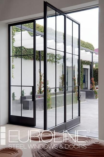 Pivot Doors in 2019 | Modern Homes | Pivot doors, Steel windows
