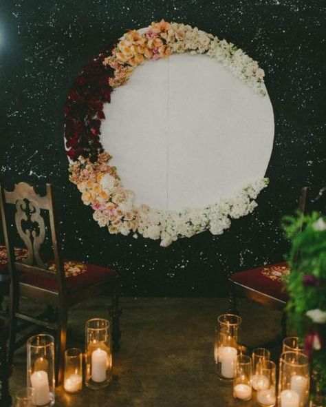 an ombre half moon wedding backdrop fully made of flowers