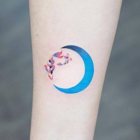 0c54d411e Fish and moon tattoo on the right inner forearm.