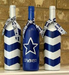 Dallas Cowboys wine bottles football decor by TheAnchoredElephant - Use this idea to create your own football DIY wine bottle crafts!