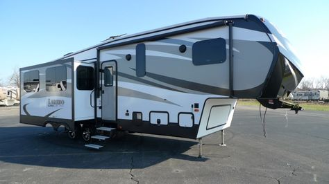 """YOU DESERVE A VACATION GETAWAY!!!  2016 Keystone Laredo 297SRE Prepare for a cinematic experience unlike any other with the 40"""" LED TV, CD/DVD home theater system, and surround sound effect speakers included in this 32' 6"""" long, 7985 lb. RV! Stain-resistant fabrics help reduce the effects of spills, while a cordless vacuum lets you clean up messes easily! Give our Laredo expert Gabrielle Selvius a call 616-890-3879 for pricing and more information."""