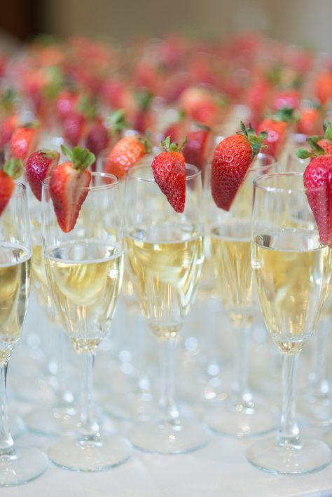 Classic Champagne Flutes + Strawberries for a pop of color | SBP Photography | See the wedding on SMP: http://www.StyleMePretty.com/canada-weddings/2014/03/07/elegant-neutrals-niagara-wedding/