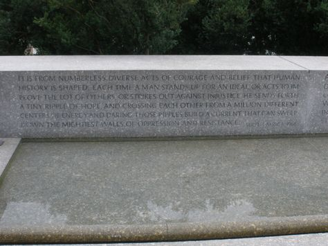 """RFK Grave Quotation:  """"It is from numberless diverse acts of courage and belief that human history is shaped. Each time a man stands up for an ideal, or acts to improve the lot of others, or strikes out against injustice, he sends forth a tiny ripple of hope, and crossing each other from a million different centers of energy and daring, those ripples build a current that can sweep down the mightiest walls of oppression and resistance."""""""