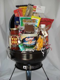 camping gift basket. small charcoal grill and fill it up