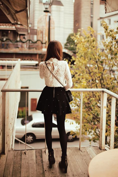 Very simple contrasting the white top with the black skirt, shoes, and tights.