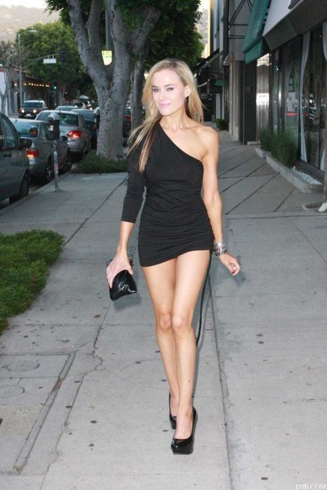 Paula Labaredas looking amazing in a tiny black dress and heels.