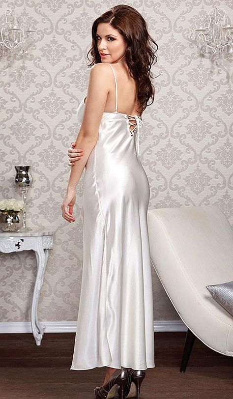 Beautiful white Satin Charmeuse long Bridal Gown has lace-trimmed cups, sexy lace-up scoop back, and adjustable spaghetti straps. Matching long satin robe with lace trimmed cuffs and self-belt tie will make a stunning peignoir set from our Bridal Lingerie Collection!