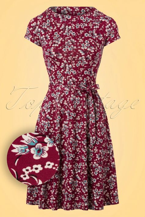 ''Ready for a tea party?'' Oh well, I absolutely am with this 60s Bohemian Flower Skater Dress!Cosiness with your friends in an amazing flower garden, the butterflies fluttering around and the smell of freshly baked cookies meets you... tea party it is! The boat neck, lovely flower print and the flattering semi-swing style makes your heart melt. Dazzlingly beautiful and surprisingly comfortable; the soft, stretchy wine red viscose blend is a joy to wear. ''I ...