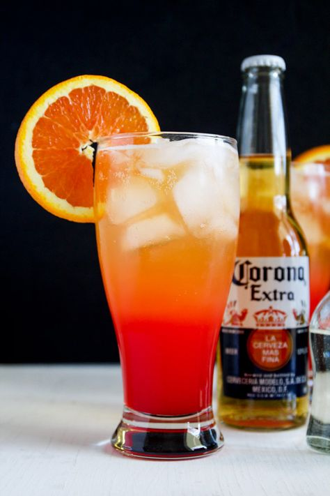 Corona Sunrise #Cocktail - #Tequila, Corona, orange juice and grenadine make this delicious cocktails. Perfect for Cinco de Mayo. #entertaining