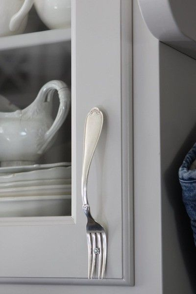 how much fun, re-using forks as cabinet pulls!