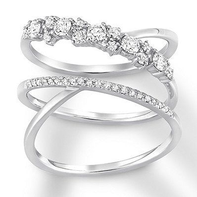 With Cascading Bands Of Sparkling Diamonds This 14 Karat White Gold Ring Creates An Optical Illusion Of Eleganc Swirl Diamond Ring White Gold White Gold Rings