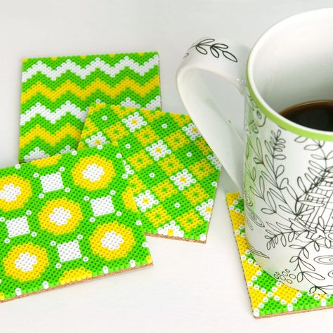 Make four different patterns with Perler Mini Beads for these zesty, citrus-colored coasters. The set makes a nice gift!
