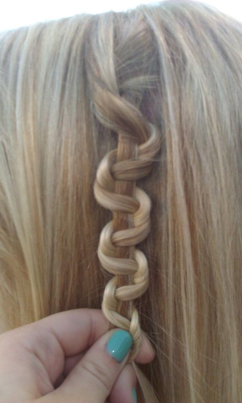 Snake braid #hair #style. You braid your hair (3 pieces of hair.) Then you push the braid up with one strand in the hand your pushing the braid up in.