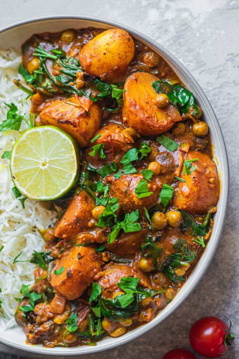 This easy vegan potato curry is a cosy, indulgent dinner that's made with healthy ingredients and ready in under 30 minutes! Add this to your dinner rotation for comfort food deliciousness every time. #curry #vegancurry #vegandinner #weeknightdinner #potatocurry