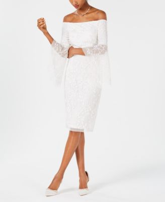 22d2a359cd737 Off-The-Shoulder Beaded Dress  319.00 A delicate arrangement of beaded and  sequined flowers scatters the light across a bell-sleeve Adrianna Papell  dress ...