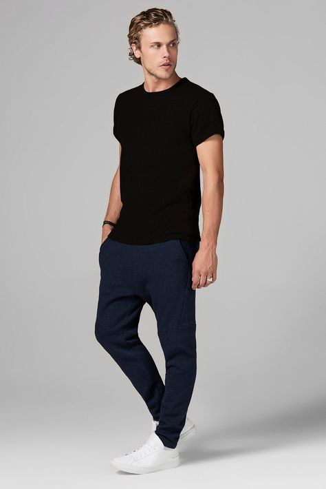 OUTSTANDING SOFT QUALITY, BRUSHED FRENCH TERRY SWEATSHIRT TEE , COLOR BLACK. SEMI RELAXED FIT. CONTENT:50%POLY/ 46%COTTON/ 4%RAYON CARE:MACHINE WASH, COLD DELICATE CYCLE, DO NOT BLEACH, LAY FLAT TO DRY, COOL IRON IF NEEDED, DO NOT DRY CLEAN SIZE: MALEMODEL IS 6' WAIST 31 AND WEARS A SIZE M Made in Los Angeles, California