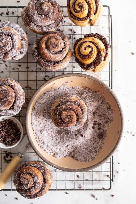 Earl Grey Buns with Dark Chocolate and Cocoa Nib Filling. Fluffy brioche dough is filled with an earl grey dark chocolate custard, and a crunchy cacao nib filling, then rolled up and sliced into buns.