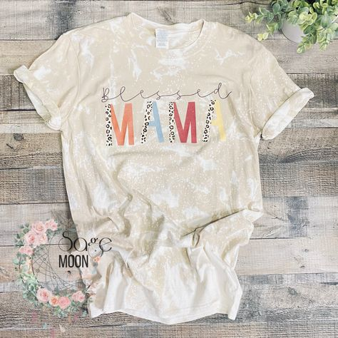 Blessed Mama, multi color/leopard print font, bleach dyed Die to the nature of bleach, no 2 shirts will be the same but we get them as close as possible Unisex Fit Ready to Ship, same or next business day 100% Cotton