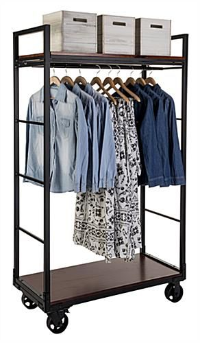 Display A Collection Of Clothing Garments On A Mobile Industrial Retail Dual Shelf Armoire Rack Top Clothing Rack Clothing Rack Bedroom Retail Clothing Racks