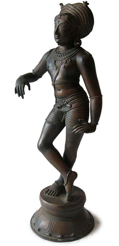 Chola Bronze Buddha Statue | Vrishvahana Transformation of Shiva | Origin: India. Circa: early 20th century. H 15 in., W 5.5 in., D 4 in. Buddhamuseum. The names and forms of Shiva are many. In the dance of many forms the Nataraj, Shiva's dance of creation and destruction they are listed as 108 in the Shiva Purana, the deity is revealed in 1000 different aspects. Vrishvahana is one of these.