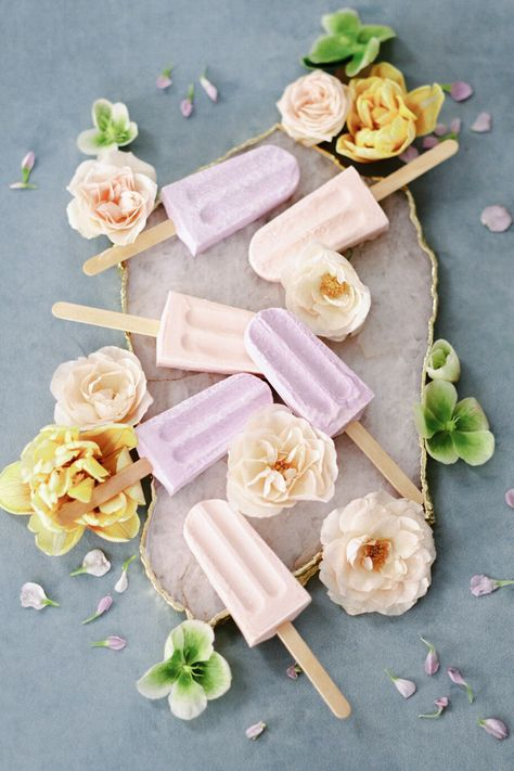 From the editorial Every Pastel-Loving Bride Will Fall Head Over Heels for This Whimsical Wedding Inspiration. Pastel popsicles, but make it fashion.😉  The perfect treat for couples looking to wow their guests with a fun and different dessert option!    Photography: @whitneyheard Popsicles: @eathappypops  #whimsicalwedding #pastelpopsicles #popsicles #weddingdessertideas
