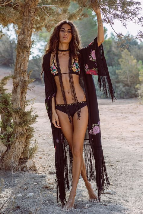ANJUNA Viola Embroidered Fringe Wrap This Anjuna Viola Embroidered Fringe Wrap features floral embroidery and fringe trim details in a relaxed wrap around silhouette.