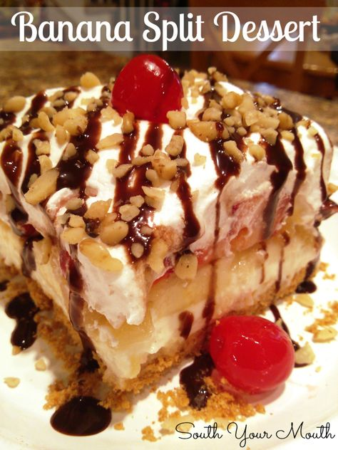 Classic Banana Split Dessert with cream cheese filling, pineapple, strawberries, chocolate syrup and nuts.