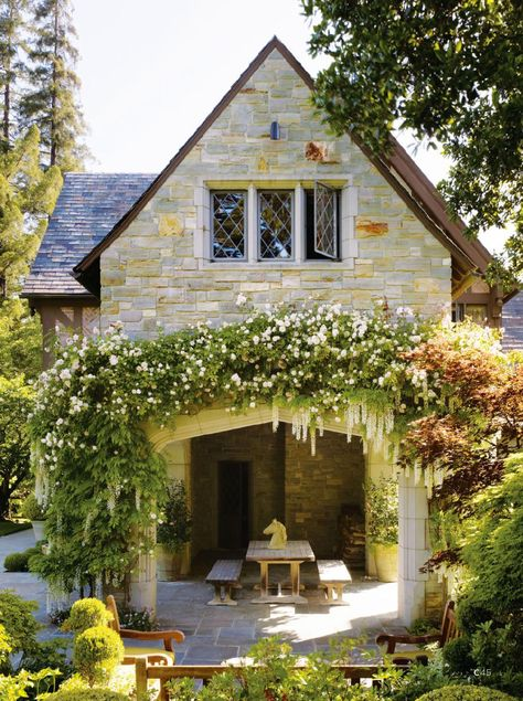 stone cottage and outdoor patio area