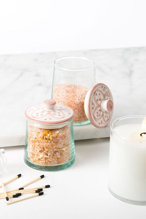 Store cotton balls and cotton swabs in this beautiful glass jar. Each purchase empowers artisans in Morocco who carefully mold and paint each piece by hand. They earn fair wages and preserve a generations-old technique.