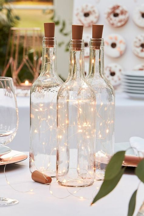 These bottle lights and cork stopper are a magical addition to your place settings. Put them in your favorite bottle and dot them around your wedding tables. Includes three cork and light strands. Wine Bottle Centerpieces, Lighted Centerpieces, Wedding Wine Bottles, Wedding Table Centerpieces, Wedding Tables, Wine Bottle Fairy Lights, Lighted Wine Bottles, Bottle With Lights, Led Fairy Lights